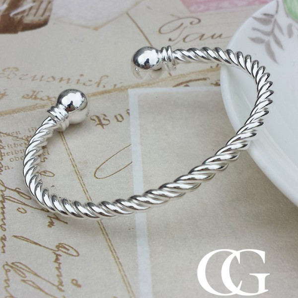 Ladies Silver Torque Bangle With A Twist Chains Of Gold