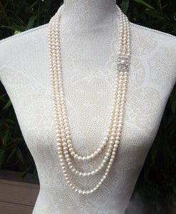 Vintage 3 row Pearl necklace with silver detail 38 inches