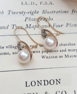 Victorian pearl earrings with a diamond adorned star