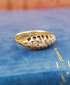 Edwardian 5 diamond ring in carved setting and scrolling shoulders