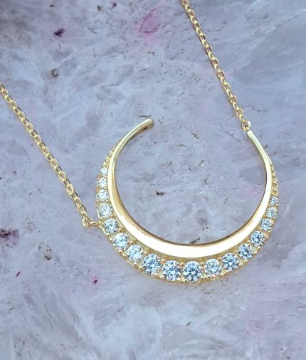 crescent moon necklace in solid 9ct yellow gold with cubic zirconia.