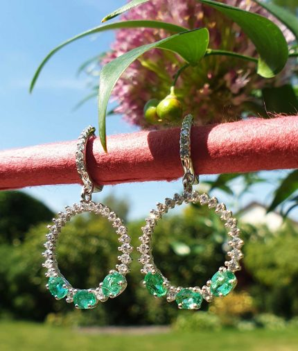 18ct white gold emerald and diamond dangly earrings
